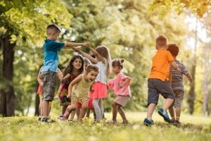 Group of happy little children having fun in the park