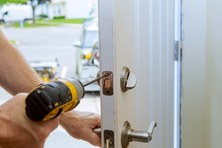 man repairing the doorknob