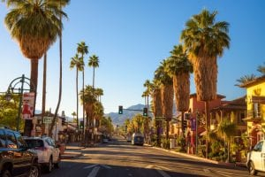 Palm Springs, California, USA - December 27, 2017 : Scenic street view of Palm Springs at sunrise. It is a desert resort city in Riverside County within the Coachella Valley.